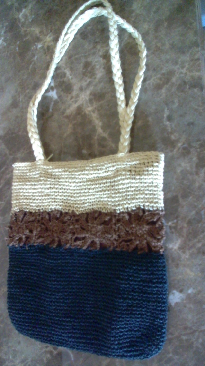 Crocheted purse in brown black and cream color