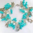 Cat and Angel Bright Aqua Blue Cha Cha Charm Bracelet