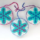 Felt snowflake ornament light aqua on white Christmas