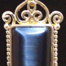SILVER TONE AND BLUE PENDANT