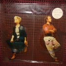 "Phil Collins Marilyn Martin Limited Ed. 7"" Set Of Two Interlocking Shaped Picture Disc Records"