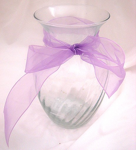 Vase with a light purple ribbon