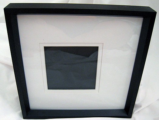 Table Picture frame: jet black and white inside, posh simple design.