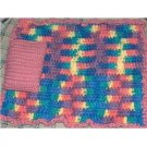 Hand crocheted Doll blanket in pink multi with a pink pillow