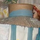 Island style vintage straw hat with pale teal colored detail and ties
