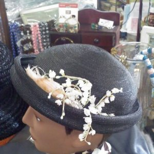 An Austelle Fashion vintage black topper hat with lily of the valley silk flowers