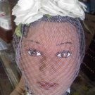 birdcage style veil white roses with lavender ribbon and net vintage hat