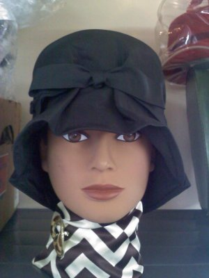 Vintage mourning hat dull black fabric but still attractive and will match any outfit