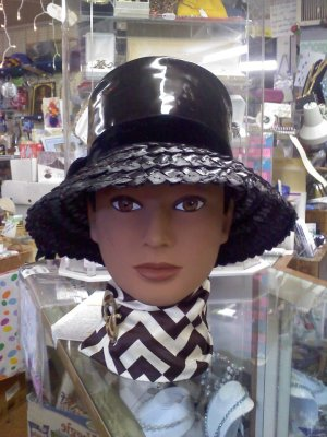 Black patent leather and straw vintage hat with velvet band and tails