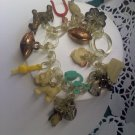 Charm bracelet with old Celluloid charms - gumball and Cracker Jack prizes