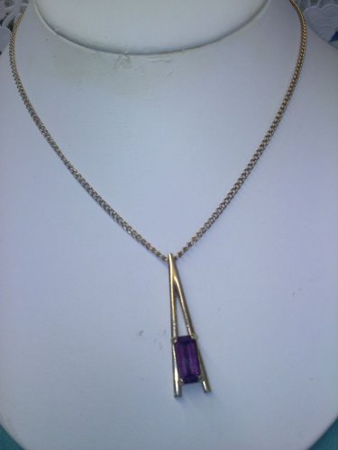"huge purple amethyst color emerald-cut stone set in goldtone 1975 ""Plaza IV"" necklace"