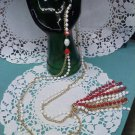goldtone chain with red and white faceted plastic beads tassel necklace 1960's