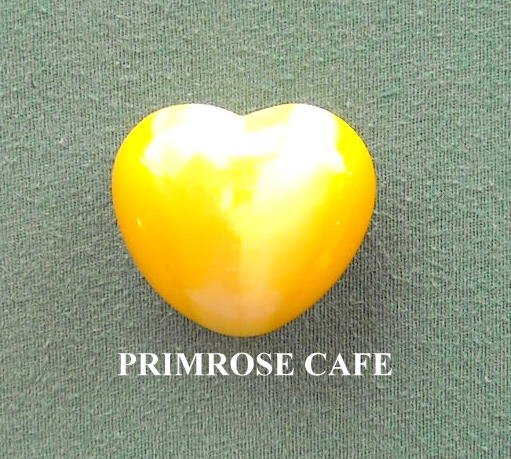 Yellow small solid glass heart shaped paperweight