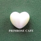White small solid glass heart shaped paperweight