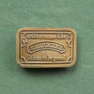 Vintage Smucker's brass belt buckle