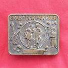 Vintage Grab your partner brass belt buckle