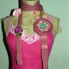Ditsy print hand knitted necktie with corsages..