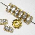 200 Swarovski Rondelles 5mm Gold/Crystal (F) - SR502