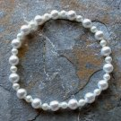 [020] Elastic White Glass Pearl Bracelet