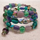 Purple, green & Teal memory wire bracelet.  Visit our store twodotts.ecrater.com