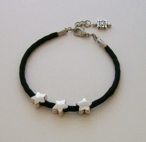 Black Paracord Ankle Bracelet with 3 Star accent beads.
