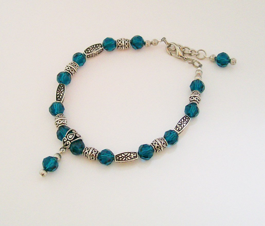 Ankle Bracelet with Teal beads and Silvertone accents.
