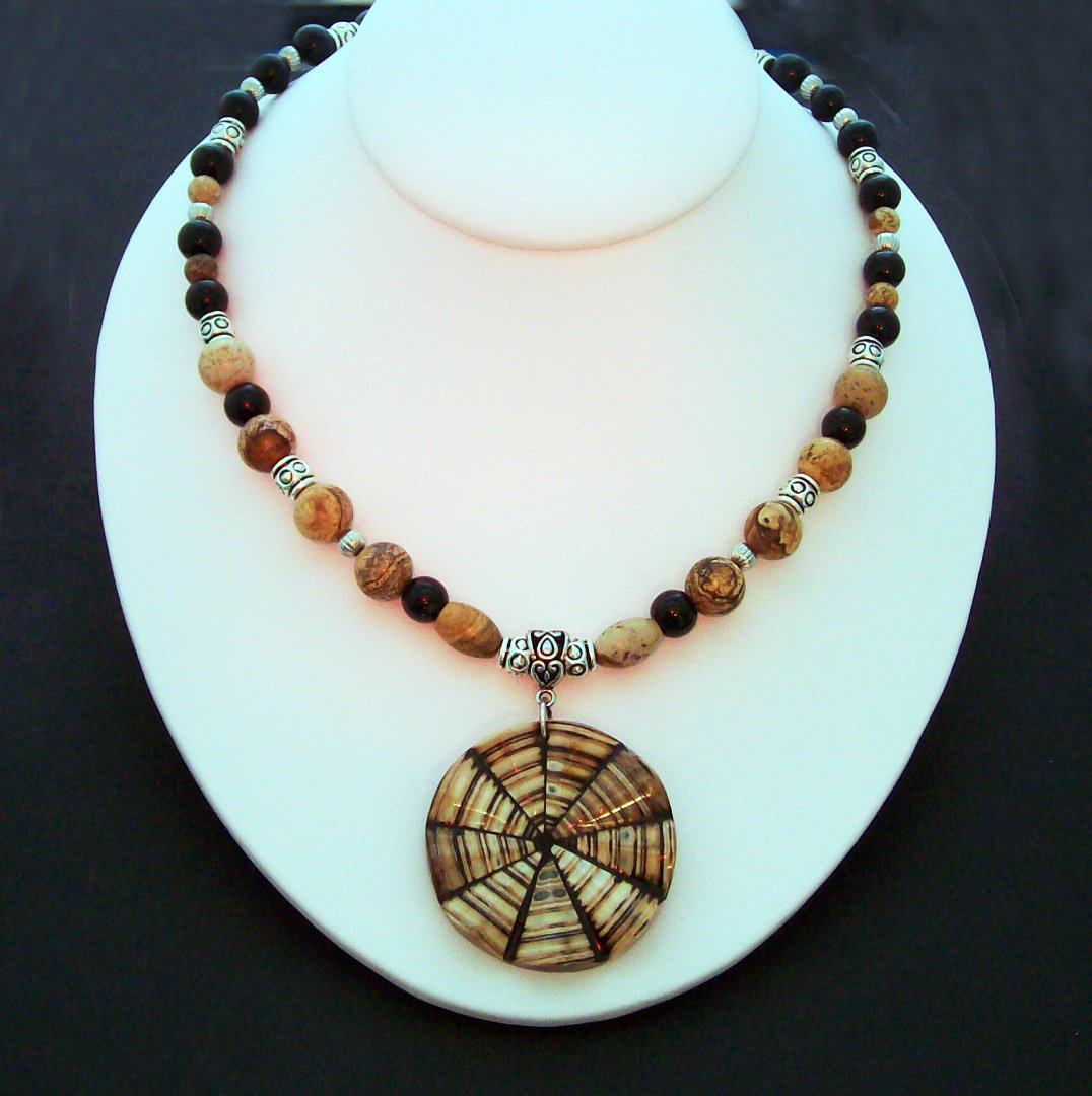 Beaded Necklace with Tan & Black beads and a Shell pendant.  Check our store twodotts.ecrater.com