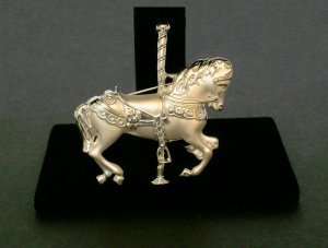 CAROUSEL HORSE PIN in a silver color.