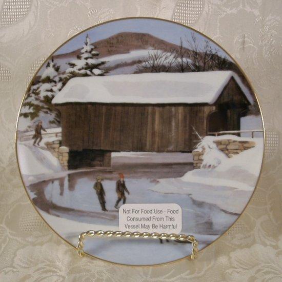 A HERITAGE HEIRLOOM WINTER WONDERLAND COLLECTOR PLATE