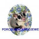 SUGAR GLIDER FORGET ME NOT ROSE UNSET PORCELAIN CAMEO 18X25 CABOCHON