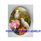 2 COCKATOO BIRD ORCHID HIBISCUS CAMEO PORCELAIN 18X25MM