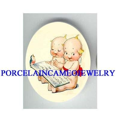 2 KEWPIE BABY READ BOOK ROBIN BIRD PORCELAIN CAMEO 1825