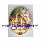 BUTTERFLY FAIRY HUGGING MOUSE* UNSET CAMEO PORCELAIN CAB