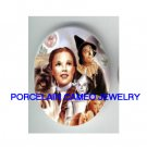 WIZARD OF OZ WITH DOG* UNSET CAMEO PORCELAIN CAB 30X40MM