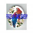 2  PARROT MACAW BIRD APPLE BLOSSOMS PORCELAIN CAMEO CAB 18X25MM