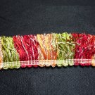 "Brush Fringe 1 3/4"", Ribbon Red, Orange, Green 21.95per yd"