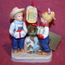 Denim Days Porcelain Figurine Sharing the Joy of Christmas 57064