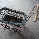Vintage wicker plant cart buggy