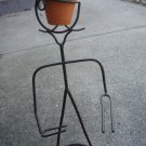 Metal plant/pot holder guy
