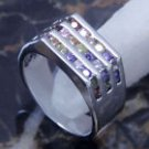 18k Multi stone channel set ring