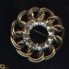 Vintage goldtone and rhinestone circle pin