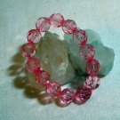 Bubble gum pink faceted lucite plastic bead stretch bracelet as new vintage ll1404