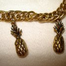 Gold tone pineapple charm bracelet snap down clasp ll1424