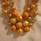 Triple strand graduated mixed plastic beads yellow orange excellent mid-century vintage ll2436