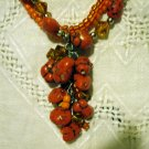 Triple strand mixed bead necklace cluster front orange turquoise amber ll2482