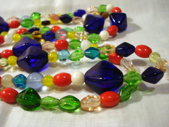 Jewel toned glass bead necklace 56 inch rope brilliant colors perfect vintage ll2592