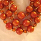 Triple strand rusty orange plastic bead necklace extender great vintage ll2923