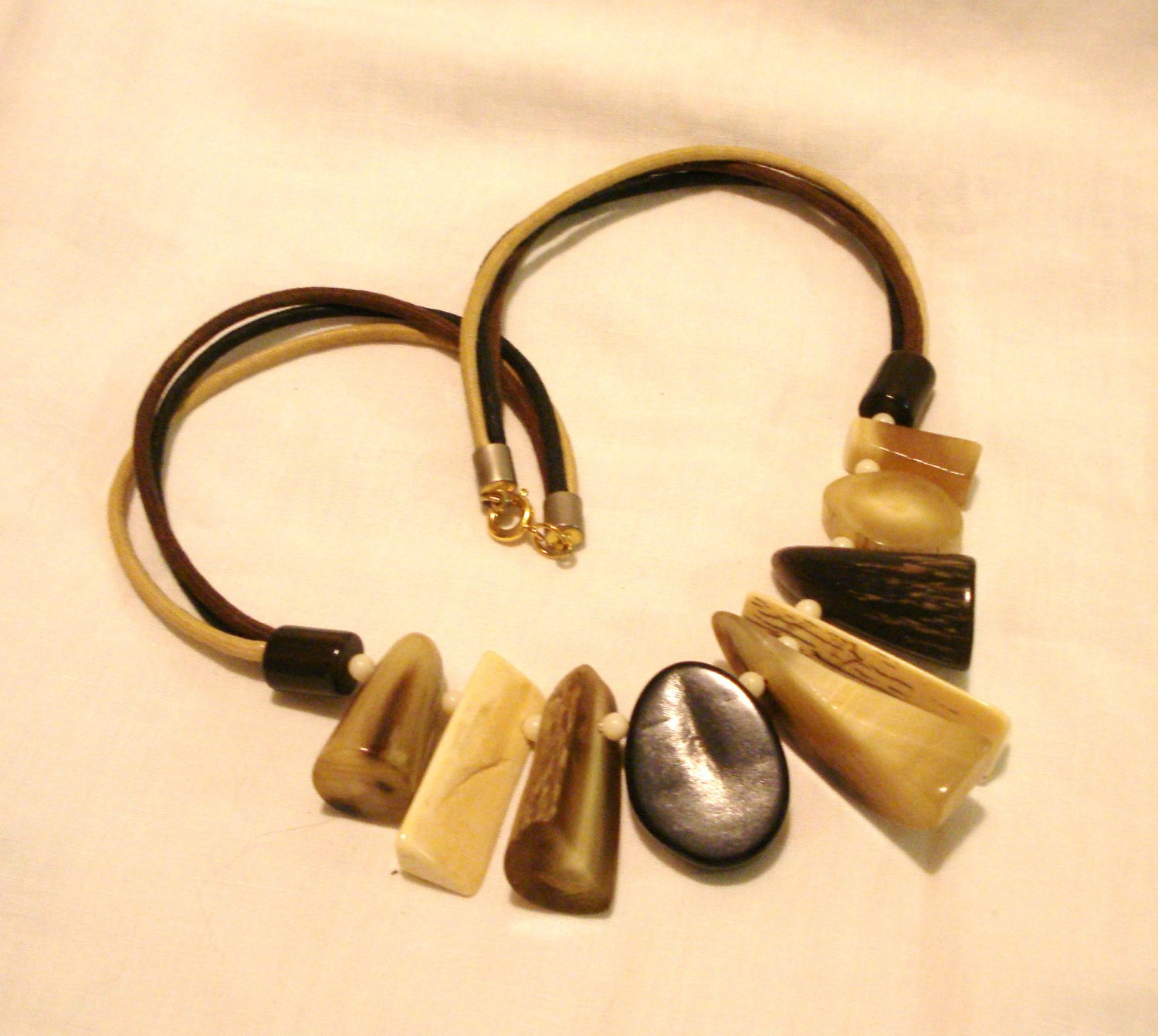 Mixed bone fragment necklace on triple cord preowned neutrals ll3182