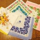 Lot of 11 vintage hankies floral printed cotton most have factory stickers attached ll3498