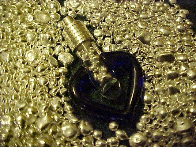 PURE SILVER BULLION ENCASED IN BLOWN GLASS BLUE HEART